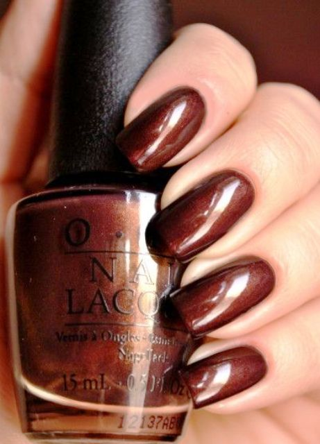 rust brown nails with a touch of shine for a bold fall look