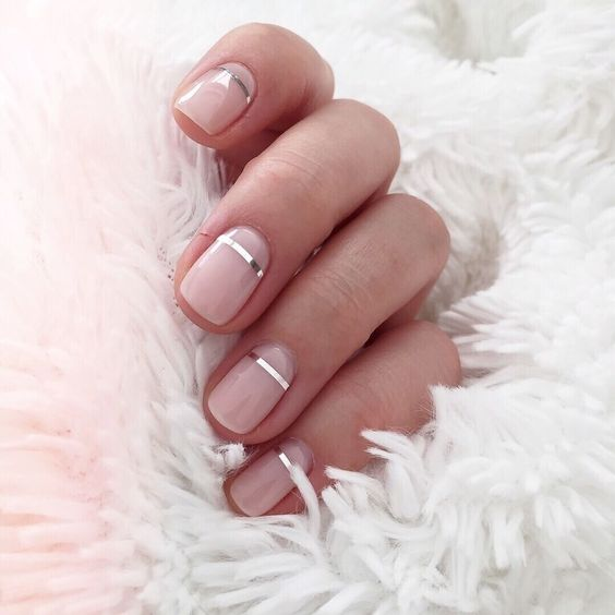 short glossy nude nails with silver stripes - metallic touches are very popular now