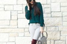 16 white jeans, plum-colored high boots, a forest grene shirt and a grey bag