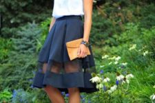 With A-line skirt, yellow clutch and leopard flats