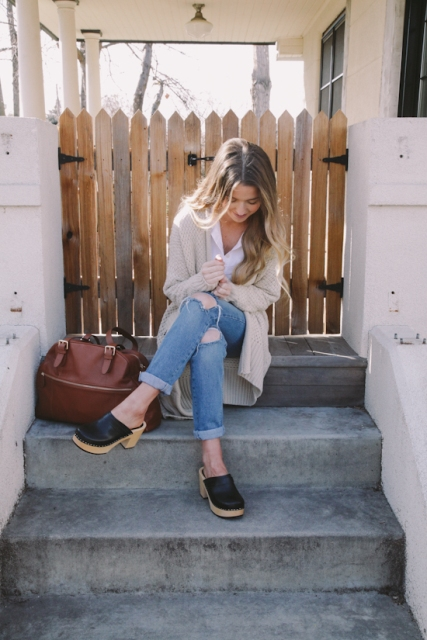 With beige cardigan, distressed jeans and marsala bag
