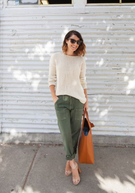 With beige shirt, olive green pants and tote
