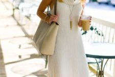 With beige tote and lace up flats