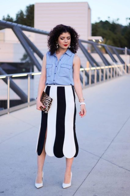 With black and white midi skirt, leopard clutch and white pumps