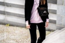 With black blazer, crossbody bag, black pants and leather boots
