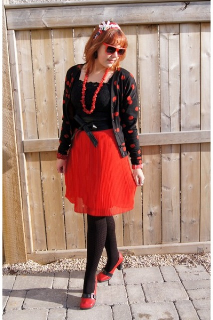 With black blouse, red skirt, red shoes and black tights