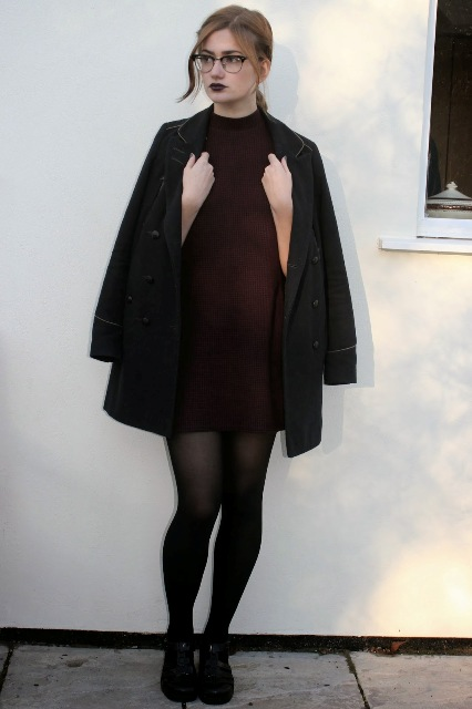 With black coat, black tights and flat shoes