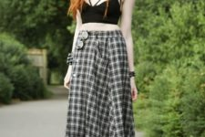 With black crop top and black flat boots