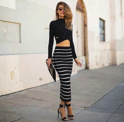 With black crop top, ankle strap heels and clutch