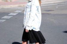 With black dress, oversized denim jacket and sunglasses