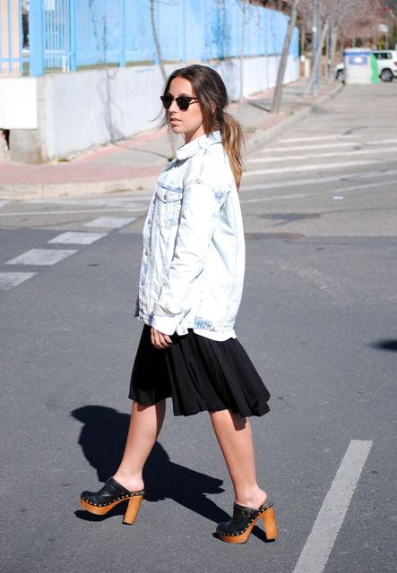 With black dress, oversized denim jacket and sunglasses