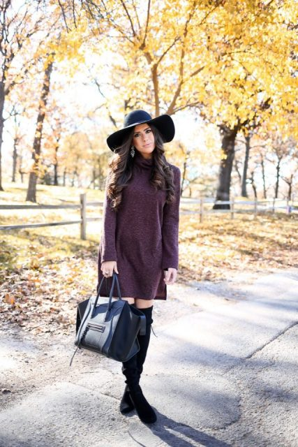With black hat, black tote and high boots