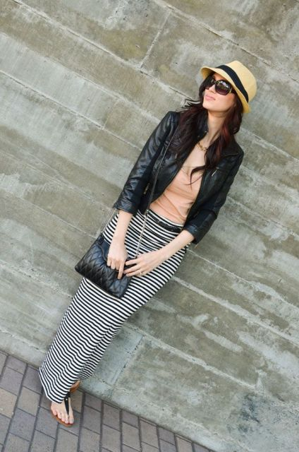 With black leather jacket, hat, chain strap bag and flat sandals
