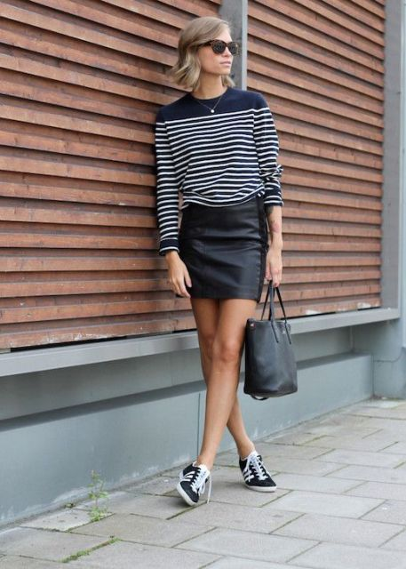 With black leather mini skirt, tote and sneakers