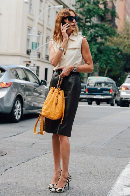 With black leather pencil skirt, yellow bag and leopard pumps