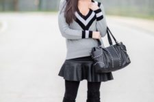 With black leather skirt, black bag and over the knee boots