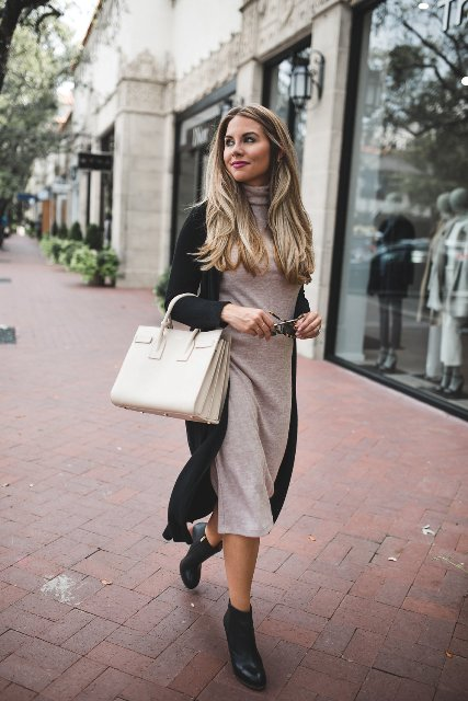 With black long cardigan, white bag and black ankle boots