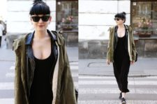 With black maxi dress, sneakers and leather jacket
