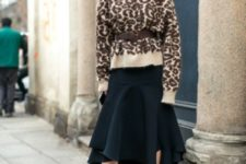 With black midi skirt, belt and black boots