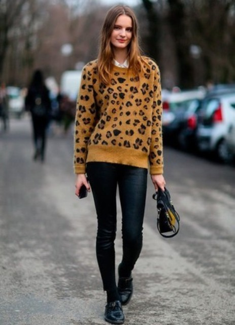 With black pants, small bag and flat shoes