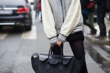 With black shorts, black tights, printed slip on shoes and tote