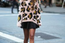 With black skater skirt and ankle boots