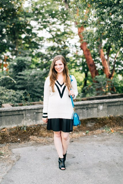 With black skirt, cutout boots and blue bag