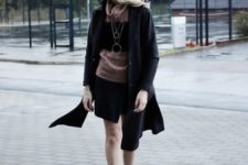 With black skirt, shirt and black coat