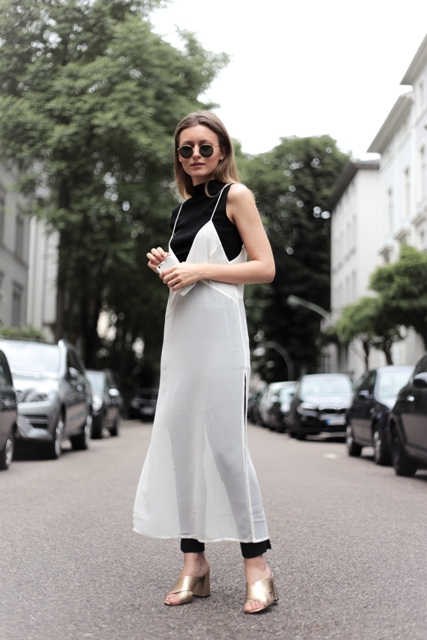 With black top, black pants and white dress