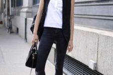 With black vest, skinny pants, flat sandals and black bag