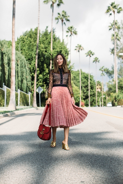 With blouse, pleated midi skirt and red bag
