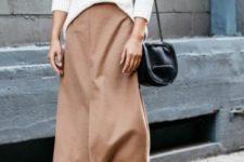 With brown midi skirt, black velvet boots and black leather bag