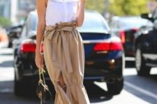 With brown ruffled midi skirt, mini bag and platform sandals