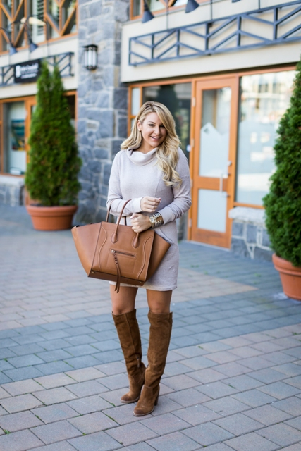 With brown suede boots and brown leather tote