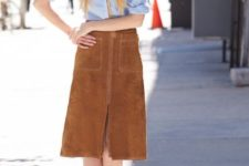 With button down shirt and suede knee-length skirt