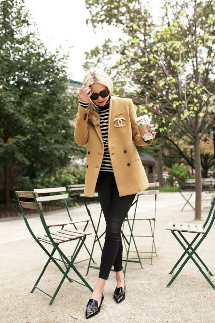 With camel coat, skinny trousers and black leather flat shoes