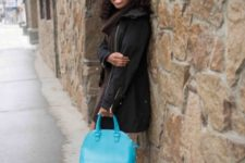 With coat, blue bag and pumps