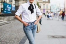 With cuffed jeans, beige tote and black and white shoes