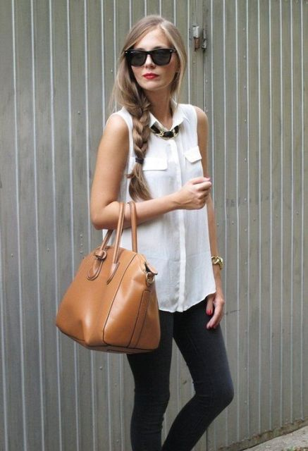 With dark colored pants and brown leather bag