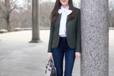 With dark gray blazer, navy blue jeans, black pumps and two colored small bag