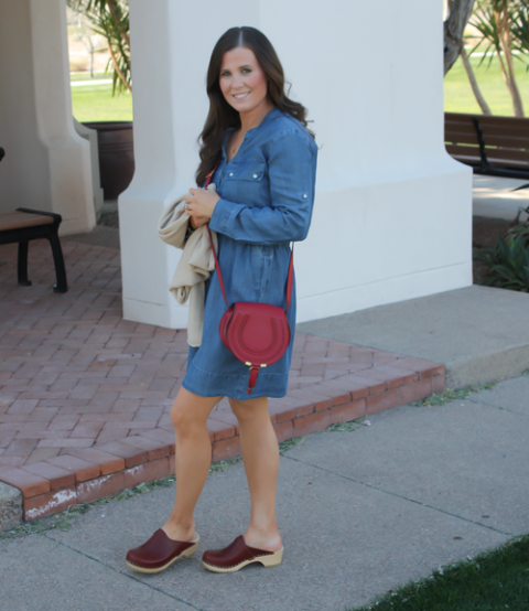 With denim dress and red crossbody bag