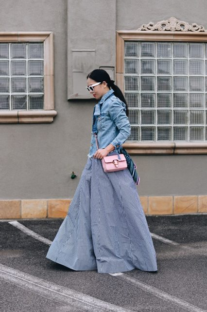 With denim shirt and pale pink small bag