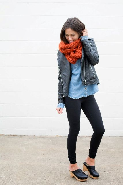 With denim shirt, black leather jacket, red scarf and leggings