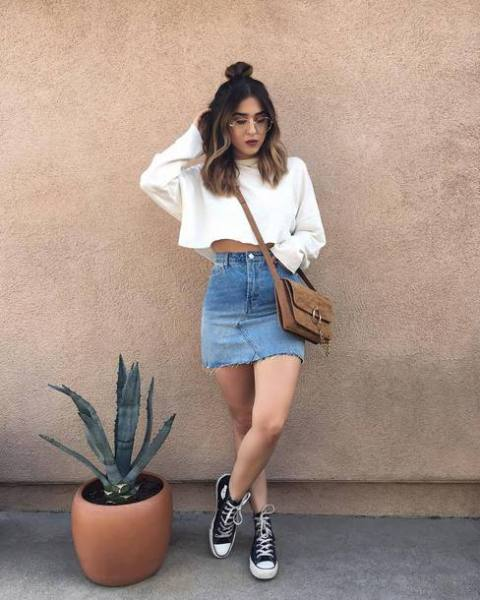 With denim skirt, brown bag and sneakers