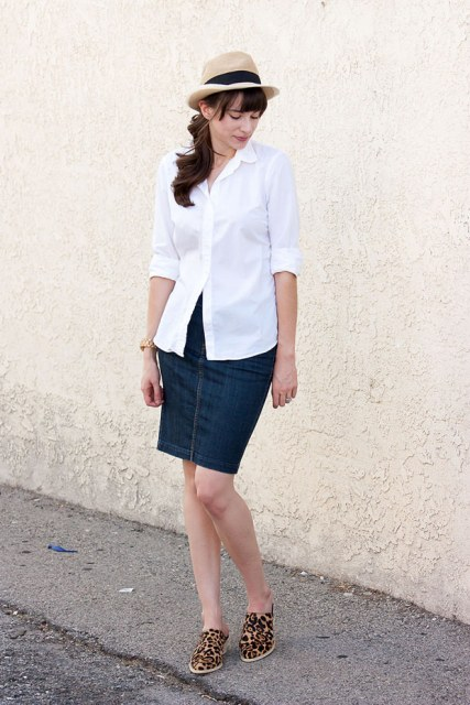 With denim skirt, white shirt and hat