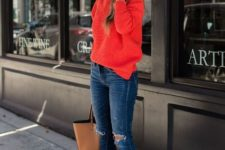 With distressed jeans, brown tote and red sweater