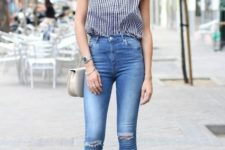 With distressed jeans, white chain strap bag and ankle strap high heels