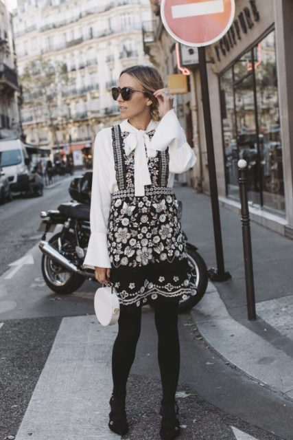 With dress, black tights, white round bag and black boots