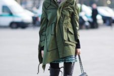 With dress, over the knee boots and chain strap bag
