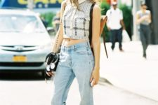 With flare jeans, white shoes and bag